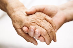 bigstock-Adult-Helping-Senior-In-Hospit-5315879