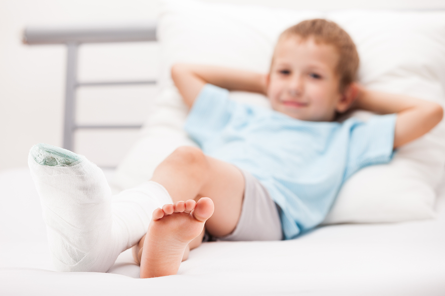 Happy Child with Cast